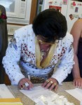 Bay Area Elvis Rick Torres signing wedding certificate