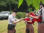 Setting up band member's pipes at the Grandfather Mountain Highland Games
