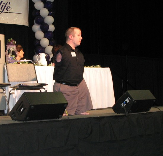 Chet, singing at the end of a presentation.