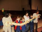The b-day boy or girl gets to help Jeanie and Ed hold their big Burmese python