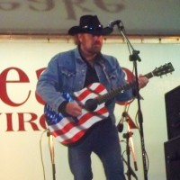 Ed Kellleher as Toby Keith - Country Singer in Silver Spring, Maryland