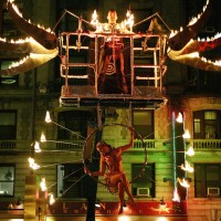 Flambeaux Fire LLC - Stilt Walker in Harrison, New York