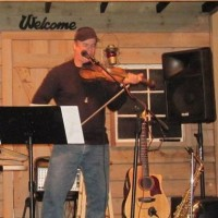 Jerry Fordham:Singer/Guitar/Fiddle/Saxophone/Flute - Fiddler in ,