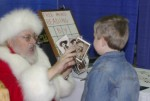 Magic Santa Claus performs Pastcards