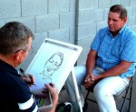 Caricature Artist John Munson Drawing A Caricature
