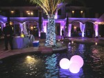 LED Uplights set to purple with three illuminated  Glow balls  floating