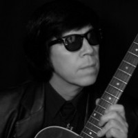 Mike Greenwood as Roy Orbison - Singer/Songwriter in Paradise, Nevada