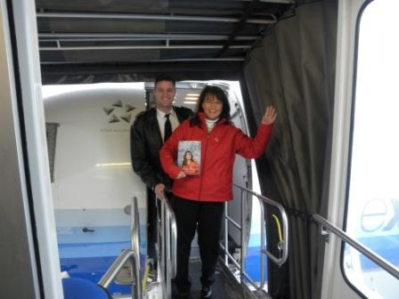 Cecilia and Pilot landing for Colorado Springs Book Tour