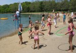 Fun on the beach with Hula Hoops at Clay's Park Resort.