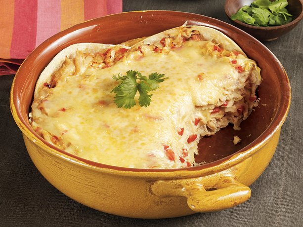 Tortilla chips layered with chicken, cheese and veggies gives you a ...