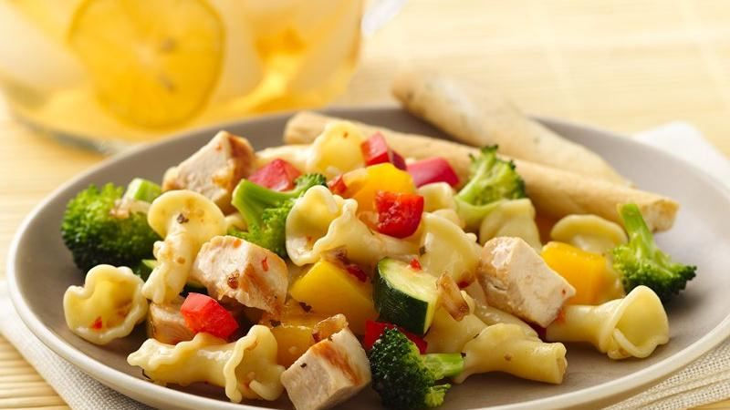 Grilled Chicken Pasta Salad with Caramelized Onion, Broccoli and Mango