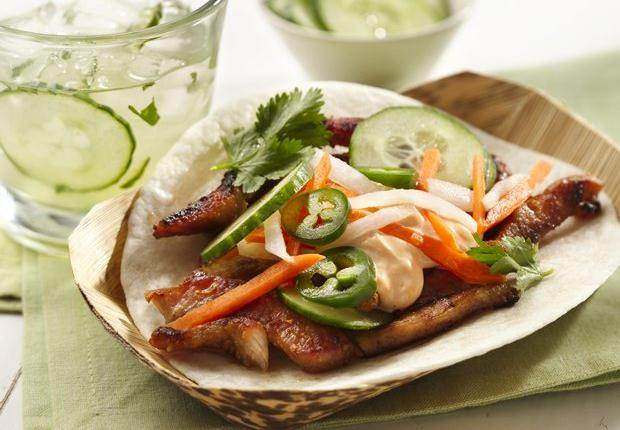 Spicy, honey-glazed pork wrapped in warm tortillas. Topped with carrot ...
