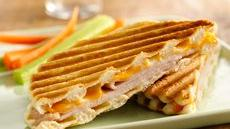 Grands! Smoked Turkey and Cheese Paninis Recipe