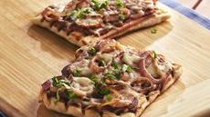 Grilled Kielbasa, Caramelized Onion and Basil Pizzas Recipe