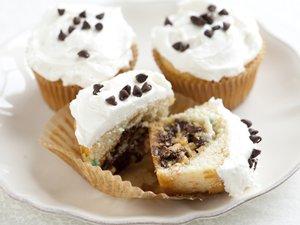 Cookie-Stuffed Rainbow Chip Cupcakes