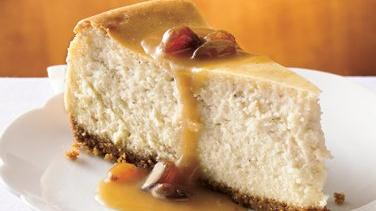 Hot Buttered Rum Cheesecake with Brown Sugar-Rum Sauce