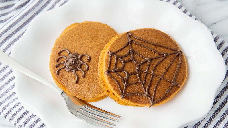 Pumpkin Pancakes with Halloween Spiderwebs
