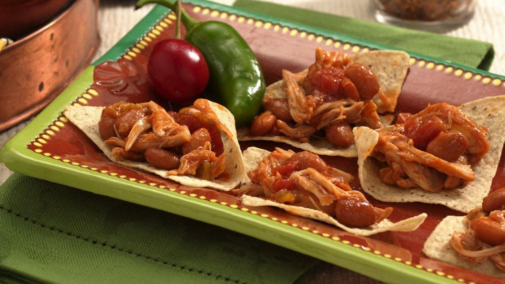 Slow-Cooker Shredded Chicken Nachos recipe from Pillsbury.com