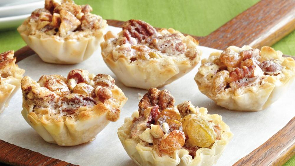 Pecan-Raisin Mini Tarts recipe from Pillsbury.com