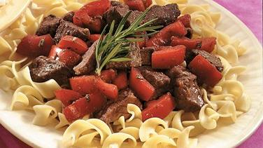 Slow-Cooked Rosemary Beef and Tomatoes over Noodles
