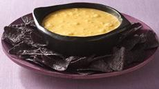Bubbling Cauldron Cheese Dip with Bat Wing Dippers Recipe