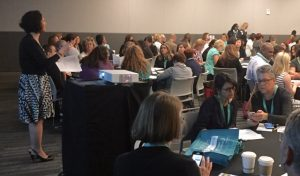 Participants at the Tell Me More® workshop at the Cleveland Clinic's Patient Experience Seminar examine the MyMoments mobile app on May 23 with guidance from Elizabeth Cleek, Chief Program Officer at the Gold Foundation.