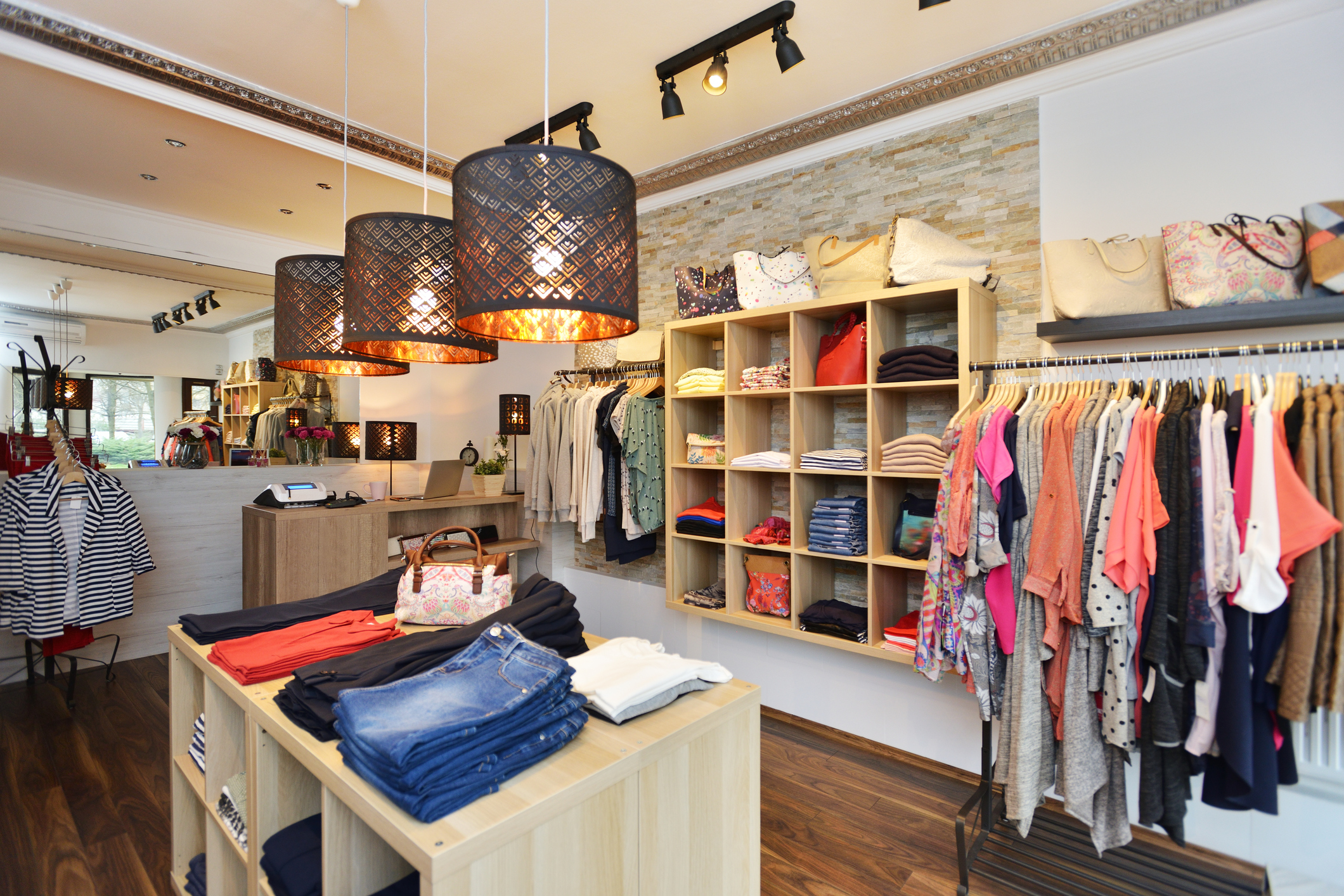 4a5318685b7 Interior of a store selling women s clothes and accessories – Golden ...