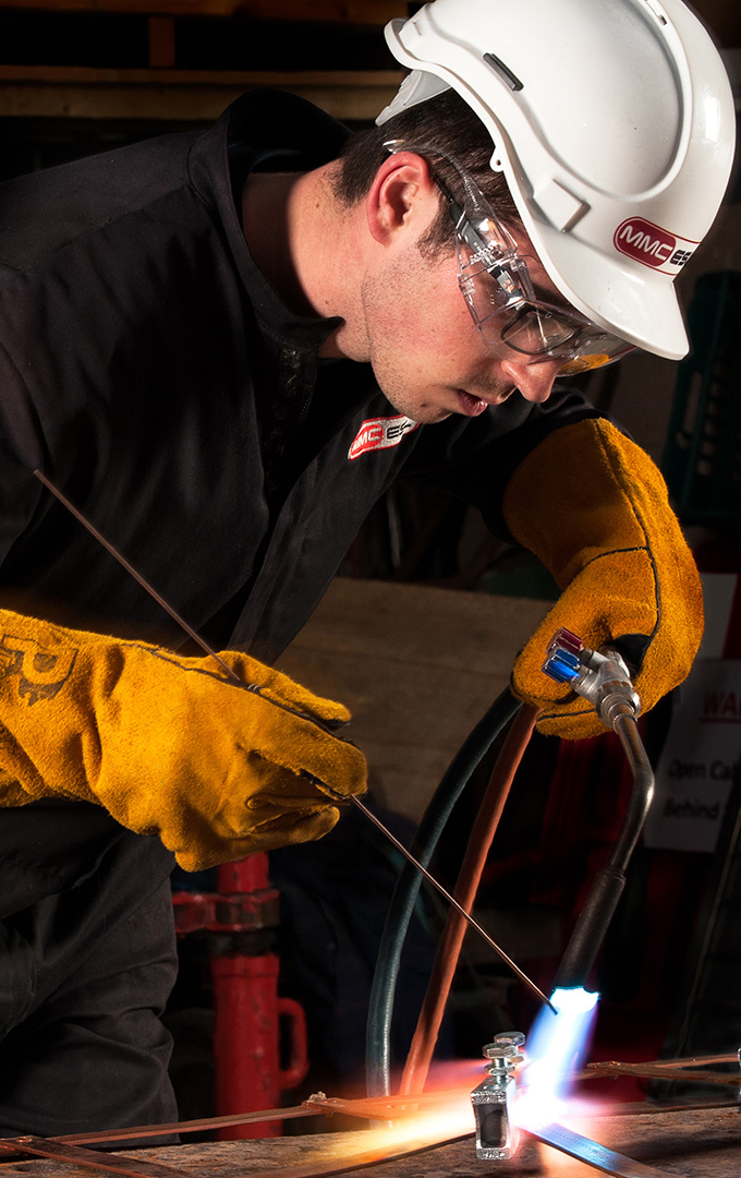 example from commercial photo shoot, showing engineer brazing 2 components at MMC Engineering workshop, Milnthorpe, Cumbria