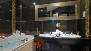 Amaryllis Hotel Room: Ensuite Bathroom with deep brown tiles and gold trim