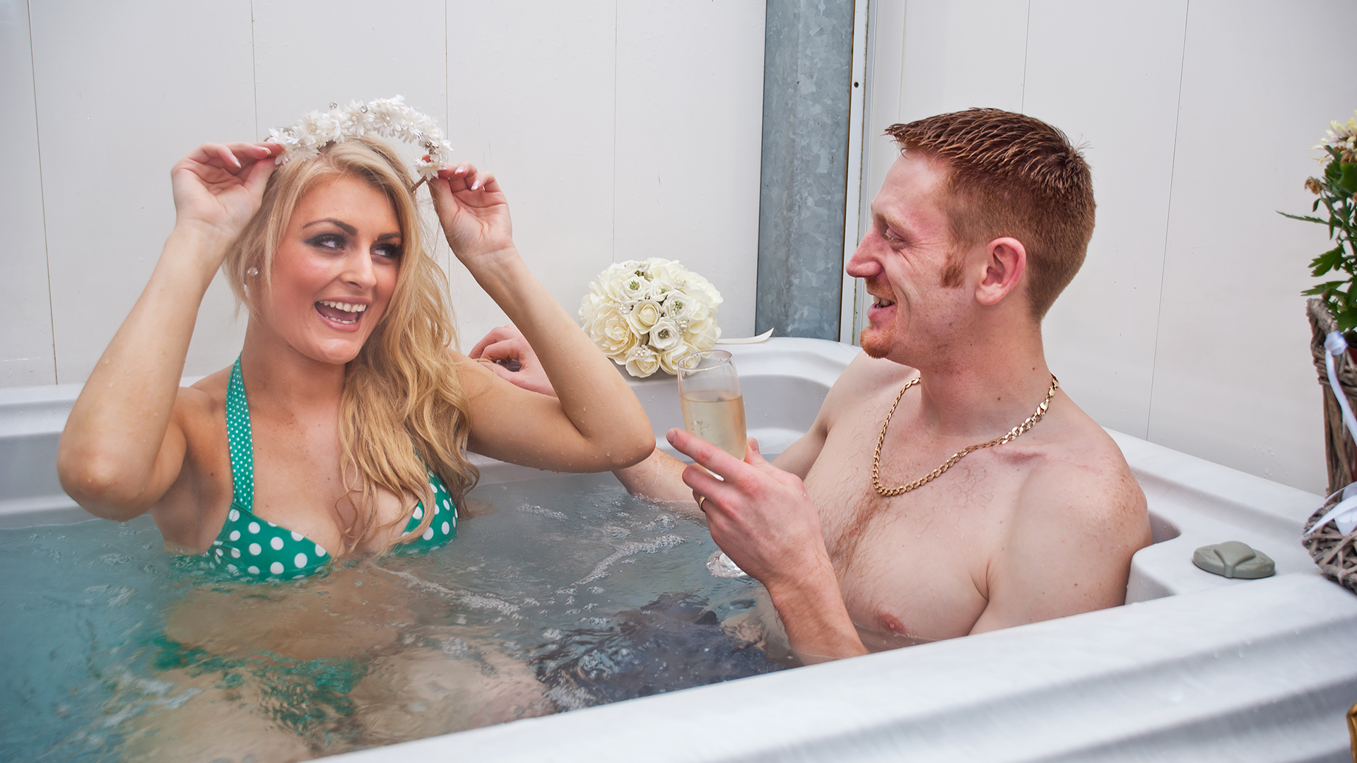 Couple Sharing Luxury Bath in Ensuite Bathroom enjoying complimentary wine
