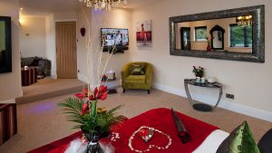 Amaryllis Luxury Room set up with flower arrangement and arty welcome pack