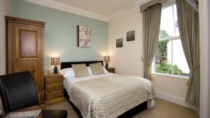 Double Bedroom Wheatlands Hotel, pine furnuiture & leather trim bed