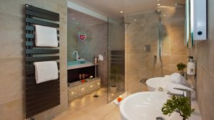 Hotel Bathroom Luxury with shower, bath, his and her sinks and towels