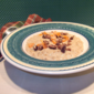 Creamy Coconut Oatmeal with Dried Peaches and Candied Coconut Pecans from Best of Fine Cooking - Breakfast, 2011