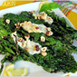 Grilled Kale with Yogurt Dressing and Toasted Hazelnuts