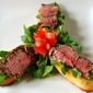 Filet Mignon and Arugula Crostini
