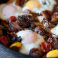 Braised Sausage and Tomatoes with Chard and Poached Eggs