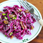 Recipe for red cabbage salad with walnuts, raisins, feta, and warm mustard dressing