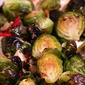 Roasted Brussel Sprouts with Sun-dried Tomatoes and Herbs