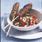 Lamb kebabs with white bean and tomato salad