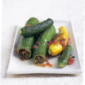 Zucchini stuffed with lamb and pine nuts