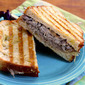 Roast beef panini recipe with caramelized onions and horseradish cheese sauce