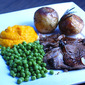 roast leg of lamb, rosemary potatoes and sweet creamed carrots