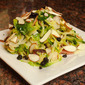 Shaved Brussels Sprout Salad with Dried Blueberries, Bacon, Almonds and Manchego