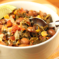 Recipe for slow cooker vegan spicy pinto bean chili with corn and kale