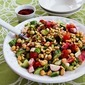 Fattoush-Inspired Chopped Salad with Tahini-Buttermilk Dressing, Chickpeas, Sumac, and Pine Nuts