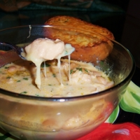 Italian White Chicken Chili Soup with Melted Cheese