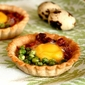 Tapa of mini-tartlets with quail eggs