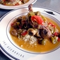 Braised Lamb Shanks with Tomatillos, Peppers & Olives