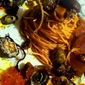 Spaghettini with seaweed on the coast of Black Sea Ognina, limpets and sea lard seasoned with olive giarresche Piedimonte Etneo, Sicilian oregano, extra virgin olive Syracuse.